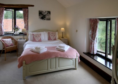 En-suite bedroom with king-size bed